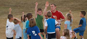 picture kids playing soccer
